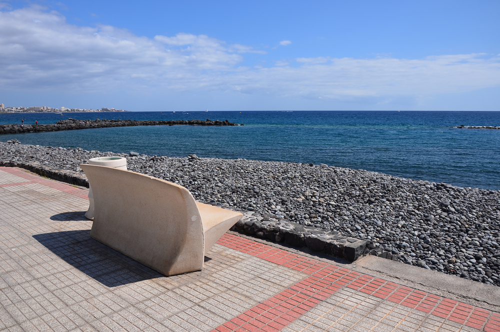 Bench on sea promenade in Costa Adeje
