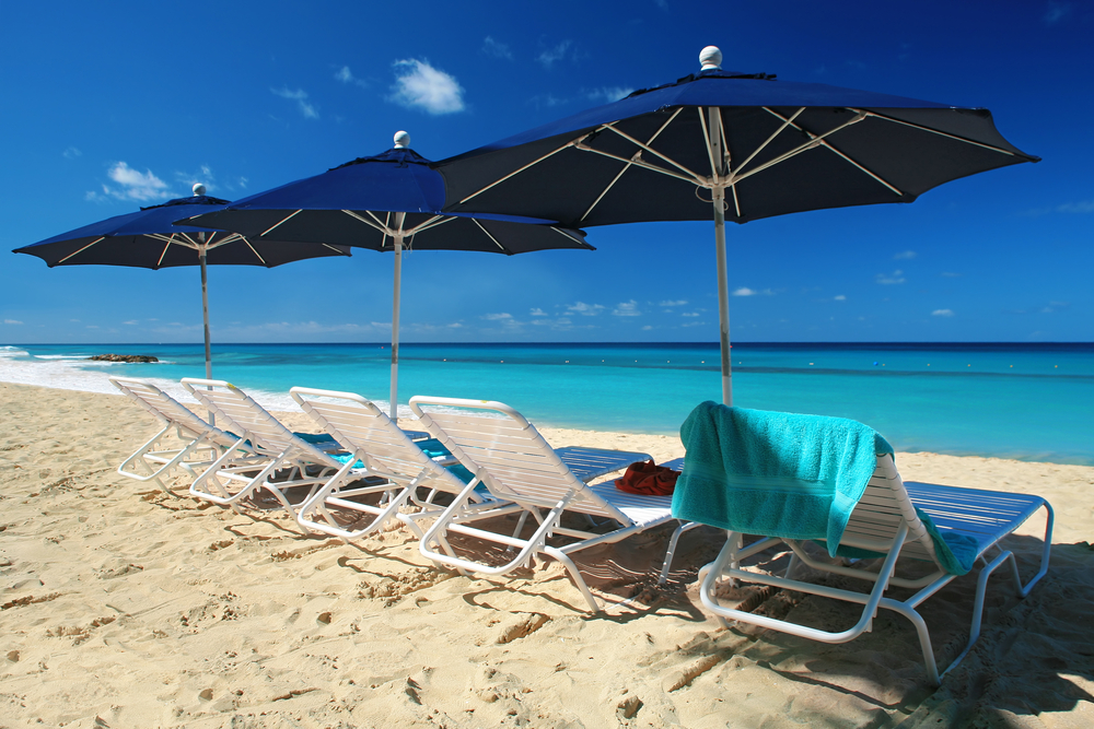 Empty sunbeds on beach in Barbados