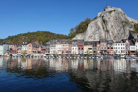 Citadelle and houses at the shore of the Meuse river in Dinant, Wallonia, Belgium.