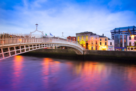 IRELAND Dublin Ireland at dusk with waterfront and historic Ha'penny Bridge
