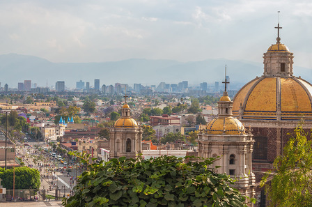 Old Basilica of Guadalupe with Mexico City skyline