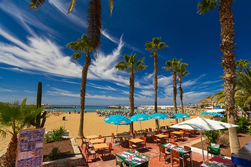 Enjoy a bite to eat at a beach side bar in Puerto Rico in Gran Canaria, Canary Islands