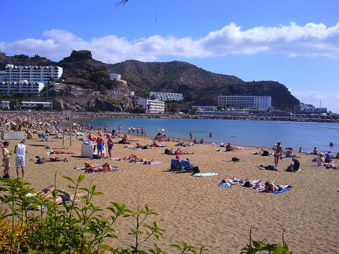 Soak up the sun at the beach in Puerto Rico in Gran Canaria, Canary Islands