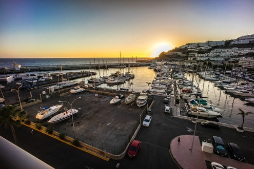Watch the sun set at the marina in Puerto Rico in Gran Canaria, Canary Islands