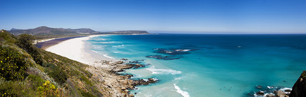SOUTH-AFRICACape Town - panoramic aerial view of surfers at beautiful Noordhoek Beach