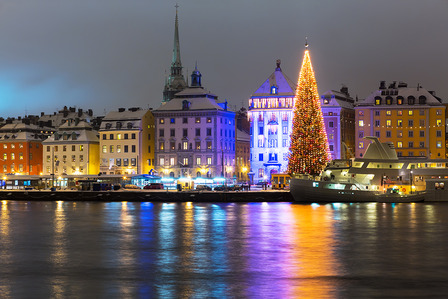 SWEDEN-Night winter scenery of the Old Town (Gamla Stan) with Christmas Tree in Stockholm, Sweden