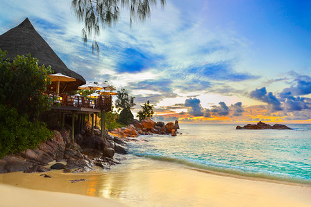 Seychelles cafe on the beach in the sunset